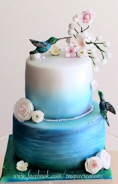 A birthday cake made for 60th with hand made and painted birds and flowers