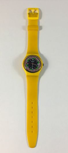 This is a vintage Swatch Watch from the 1984 (second year Swatch made watches) Spring/Summer collection. The watch is in near mint condition and excellent for its age. Original band. A new battery will be installed prior to shipping.  Name: Yellow Racer Product number: GJ400 Standard Gents Year: 1984 Spring Summer Collection Diameter case: 33.90 mm Hand colors:Grey Grey Red  I have many other Swatch watches that are not displayed in my Etsy shop because it takes time to list them all. If...