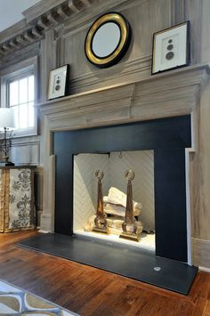 Beautiful living room with gray washed wood paneled wall and fireplace with gray washed molding and dental trim.