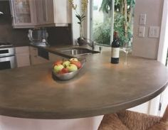 Kitchen counter ideas- I love this color of concrete and the smooth edeges