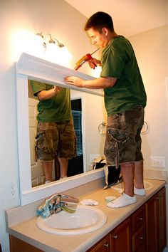 framed mirror - diy - trim, crown molding, liquid nails. What a difference it makes!