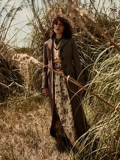 Photographed by Tomas de la Fuente, the model poses outdoors in the fall…