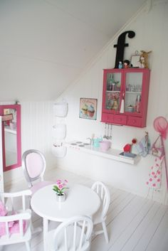 white and pink girl's room