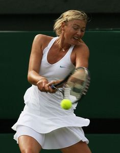 Maria Sharapova of Russia plays a backhand during the Women's Singles second round match against Severine Bremond of France during day four of the Wimbledon Lawn Tennis Championships at the All England Lawn Tennis and Croquet Club on June 28, 2007 in London, England.