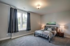 Guest bedroom. Designed and built by Quail Homes of Vancouver Washington.