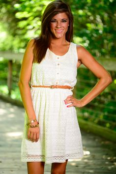 This white dress will make all your dreams come true! The great fit and gorgeous lace overlay is simply divine! The adorable belt that comes with it is amazing! Look southern chic in this beauty!