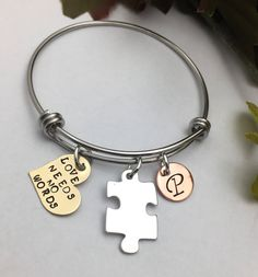 A personal favorite from my Etsy shop https://www.etsy.com/listing/521311012/charm-bracelet-bangle-bracelet-autism
