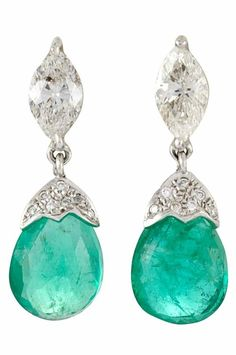 White Gold, Diamond and Emerald Pendant-Earrings . 18 kt., 2 marquise-shaped diamonds ap. 1.45 cts., 2 drop-shaped emerald briolettes ap. 6.90 cts. (Via Doyle New York.)| Diamonds in the Library