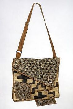 Tapestry bits + old leather + stitching = amazing shoulder bag.