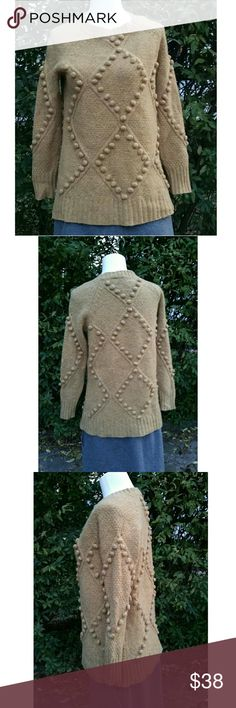 Anthropologie Moth XS Butterscotch wool Sweater This chunky sweater from Moth has a argyle style diamond pattern with yarn ball accent design throughout. Rich speckled weave of tan and golden tones. Ribbed cuff and waist. Great statement sweater. Note 1 pic with slight hole in back arm top.   17 1/4 in armpit to armpit 26 in. Length Anthropologie Sweaters Crew & Scoop Necks