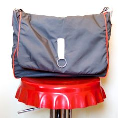 upcycled grey canvas messenger   shoulder bag  salvaged orange waxed cotton lining, repurposed belt leather shoulder strap  made entirely here in our Isle of Wight workshop, by the sea
