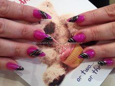 Stiletto nails with pinky purple gel polish with zebra print nail art
