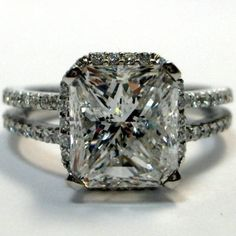 Yes, PLEASE!!! :) My dream for sure! That's basically exactly what I want!!!!!!! Except not vintage looking.  Nice sparkly diamonds and standard princess cut.