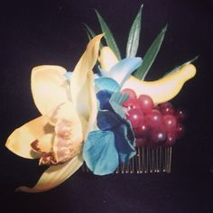 Tropical haircomb with fruit and blue and yellow flowers. ..selling for $12 plus shipping leave your email to purchase:) #deadlydinaaccessories #tropicalflowers #aqua #yellowtones #fruit #carmenmirandainspired #luau #tikioasis #tiki #hairflowers #hairpiece #hairaccessories #haircomb #pinup#retro