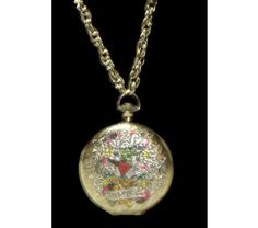 http://www.bonanza.com/listings/altered-art-up-cycled-vintage-locket-ed-hardy-design-theme-necklace/209754302