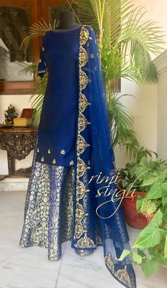 Look up, we are all under the same starry sky...   Midnight blue pure silk kurta, teamed with a midnight blue kimkwab lehenga and a matching net dupatta. There is zardozi embroidery on the edge of the dupatta, sleeves and edge of the kurta....