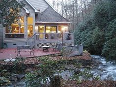 5140 Wayah Rd Franklin NC This magnificent home is at ft. elevation and bordered on two sides by US forest service and sits beside TWO bold creeks that merge on the property with about 400 ft. of creek frontage. Vacation Rental Sites, Vacation Destinations, North Carolina Cabins, Us Forest Service, Mountain Homes, Cabin Rentals, Ideal Home, Beautiful Places, Mansions