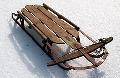 wooden sleds w/ metal blades