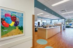 "Within each of the clinics, families have access to natural light and views of the front waiting area. Artwork within the clinic spaces not only adds color and visual interest, but it's also interactive with hidden objects for kids to ""seek and find"" while waiting for their treatment. Photo: William Manning Photography/William Manning."