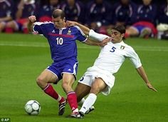 Zidane, pictured avoiding Fabio Cannavaro's tackle, won the 2000 European Championship wit...