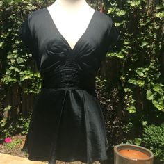 Silky black top - gifted with purchase Silky black top. Ties in back. Gently worn. Express Tops Blouses