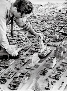 "'This photo, taken in 1940, shows an insanely detailed model of downtown Los Angeles, a WPA project that was displayed at the Museum of Natural History. The photo is one of hundreds in a new Taschen book called ""Los Angeles: Portrait of a City"".'"