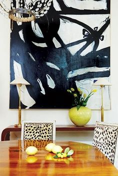 major statement art, graphic print on chairs, waterfall console, traditional chandelier