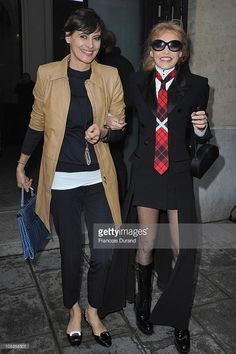 Ines de la Fressange (L) and Arielle Dombasle arrive at the Jean-Paul Gaultier show as part of the Paris Haute Couture Fashion Week Spring/Summer 2011 at Atelier Jean-Paul Gaultier on January 26, 2011 in Paris, France.