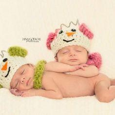 newborn twins wearing matching snowmen hats