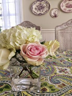 Bring spring to your table with fresh flowers and a fanciful European cotton tablecloth from HomeGoods.  Dining rooms often lack color and pattern, and tablecloths in updated styles can be the answer to bringing warmth and charm to the space.  Sponsored pin by HomeGoods.