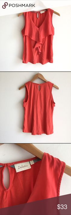 Deletta Red Ruffle V Neck Sleeveless Blouse Mixed media fabric; cotton/modal body for a comfortable wear with a little stretch and a polyester trim. Ruffle detailing down the front. Keyhole opening with button on back. V neckline. Excellent condition. Anthropologie Tops Blouses