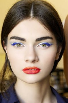 Wear a classic cat eye in a bright blue hue and add multiple coats of mascara in the same pop of color.