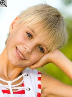 Pixie cut for little girls. A practical and easy to care for hairstyle with irregular jagged bangs.