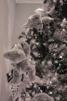 Sweet soft teddy bears climb and play all over a family room tree