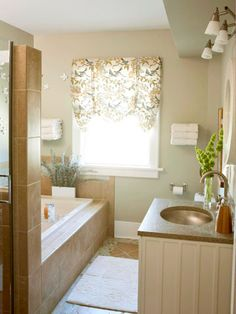 Smooth the hard lines of a bathroomwith fabric. Use a pretty print or bold color that coordinates with your shower curtain to enliven the window (or windows) with shades or valances. Add a matching cushion to a vanity chair or stool. Bring in towels that play off the colorsin your fabrics./