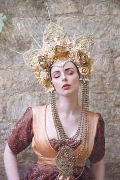 The Sunburst headdress is definitely a statement piece - its made from luxurious golden silk and lace, adorned with a vast array of glitter and