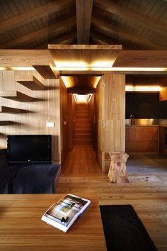 the light accents compliment the geometry of the space wonderfully... would've added some under/around the stairs too