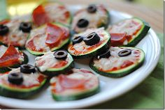 Mini zucchini pizzas. I am making these stat! (These would be amazing strictly veggies, too!)