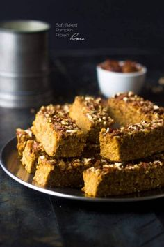 Pumpkin Protein Bars - They taste JUST like pumpkin pie but are easy, #glutenfree and great for on the go breakfasts or snacks!   Foodfaithfitness.com   #pumpkin #proteinbar #recipe