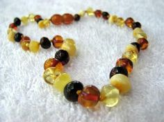 I've been reading a lot about the benefits of Baltic Amber for teething pain (and other pain too, for that matter). Pretty interesting subject. Love this necklace from http://pinterest.com/crunchychicbaby/