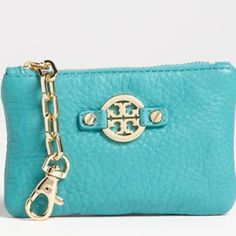 NWOT Tory Burch Amanda Wallet in Turquoise New without tags beautiful Tory Burch Amanda wallet/ coin purse with two key chains. One can clip on to your purse while the other (inside) can hold keys. Great turquoise color with gold hardware. Tory Burch Accessories Key & Card Holders