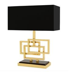 A wondrous creation by Eichholtz. The Eichholtz table lamp Margeria is the depiction of beauty, with a gold base and a brown shade the lamp will add class, glamour and style to your home. Brass Table Lamps, Brass Lamp, Sweetpea And Willow, Indian Table, Bespoke Sofas, Contemporary Lamps, Sofa Design, Designer, Ankara