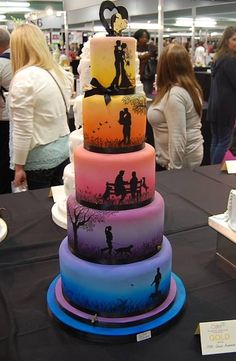 Love story wedding cake with each tier different ombre colours and cake art showing the couples life, beautiful original wedding cake by https://www.facebook.com/globalsugarart #modern #cakedesign