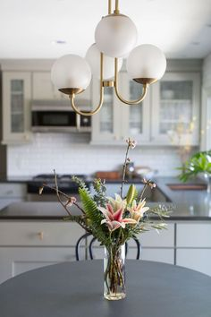 Kitchen and living room makeover. We take an outdated ranch, throw in a splash of modern vibes and watch the design truly pop! What a beautiful, mellow home!