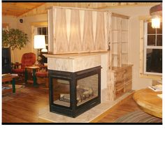 Multi-purpose Room Divider in Rustic Hickory. containing 3-sided fireplace, rotating TV cabinet, audio, book and display shelves