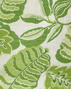 Fitzroy Fabric Large green abstract leaf design printed on a light neutral cloth.