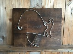 How super fun is this fisherman string art for your dad who loves to fish? This fish string art will make a perfect Fathers Day gift, Christmas gift or birthday day gift to that outdoorsman in your life! Fishing string art measures 11x14  String art comes ready to hang.  Each item is made to order. Please allow 2-3 weeks for completion and shipping of item.  Will ship USPS along with a confirmation number.  *Please note you will NOT be receiving the exact item in the picture but a duplicate…
