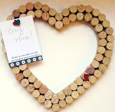 heart wine cork bulletin board. hmm, around a chalk board so you can also write notees!!!