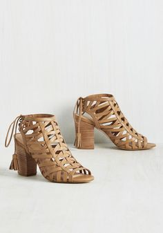 There are two types of people in the world - those who admire these tan peep toes, and those that dare to flaunt them! Slip into the braided leather uppers of these haute stacked heels, take their tassel-tied slingbacks for a spin, and you'll see that the latter group is right where you belong!