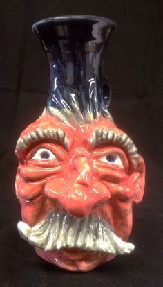 Face Jug, cone 6, clear glaze with underglazes  By Dave the Potter